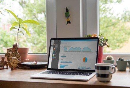 epos now reports on laptop coffee