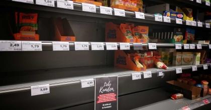 pexels roy broo empty shelves grocery items
